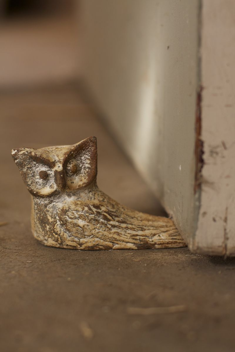 antique white cast iron owl doorstop  He is so chaarming  I would take him home too.