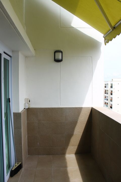 Half-tiled Walls At Balcony With Retractable Awning