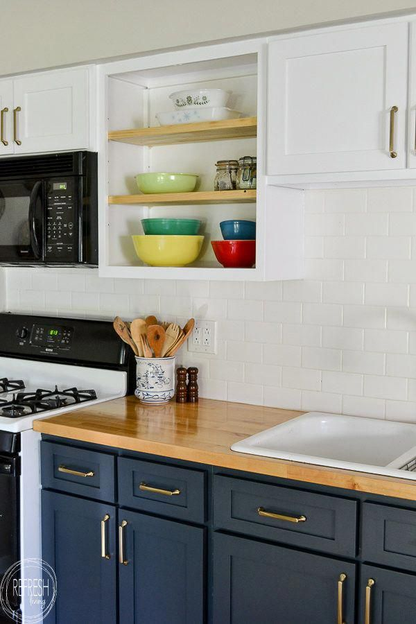 Love the dark blue with the butcher block countertops and ...