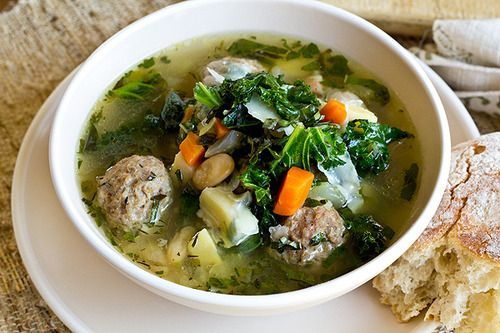 Food: Eleven Soups To Try This Week  (How healthy does this Rustic Vegetable Soup with White Beans and Spicy Herbed Meatballs look? Via The Cozy Apron)