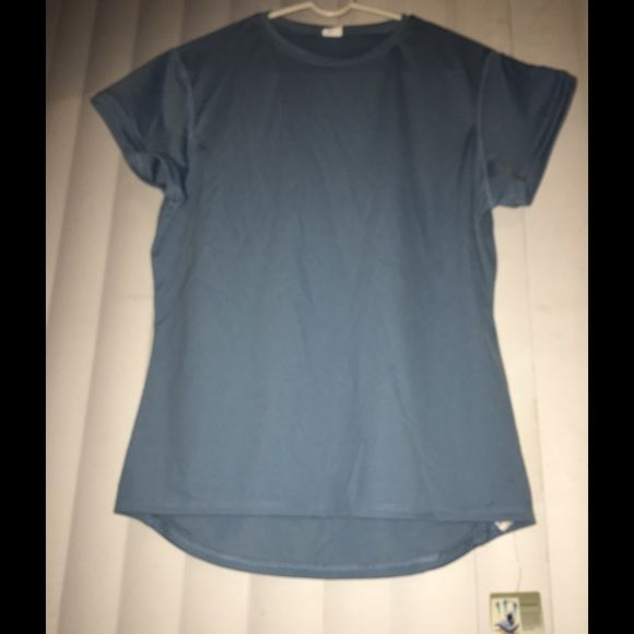 Sky blue athlete top Never worn , good condition , material : 100 % Polyester , keeps you cool and fresh with excellent moisture transport and breathe ability , enchanting your performance and endurance even in heavy activities . Tops