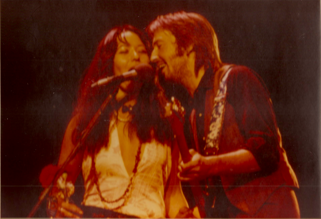 """Yvonne Elliman and Eric Clapton in concert 1974 singing """"Willie And The Hand Jive"""". """"Willie And The Hand Jive"""" is a song written by Johnny Otis - from yvonneelliman.com"""