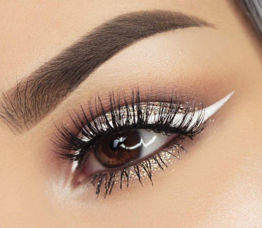 Stunning gold eyeshadow with white eyeliner