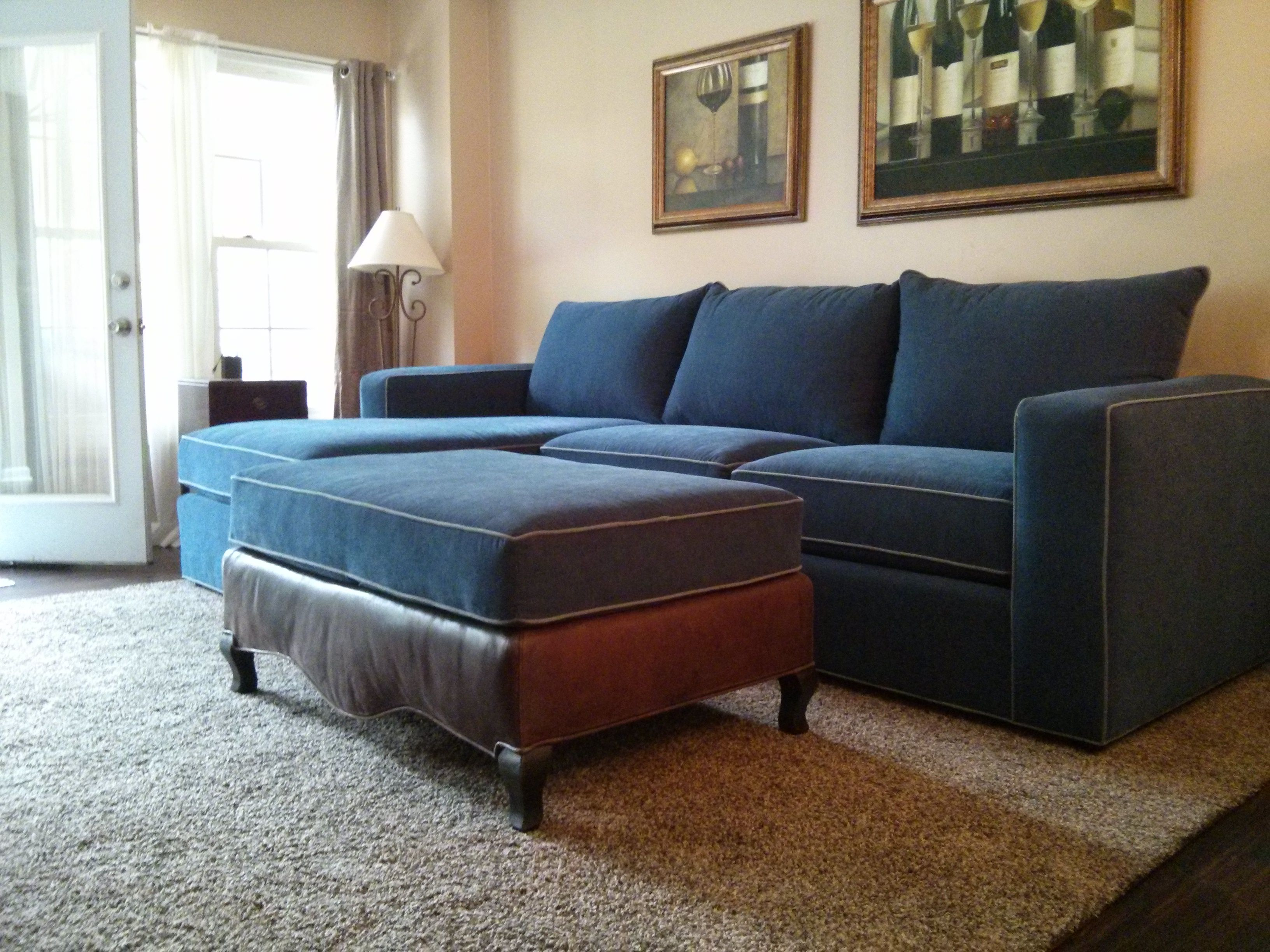 Reupholstered sofa and ottoman Material used is blue velvet with