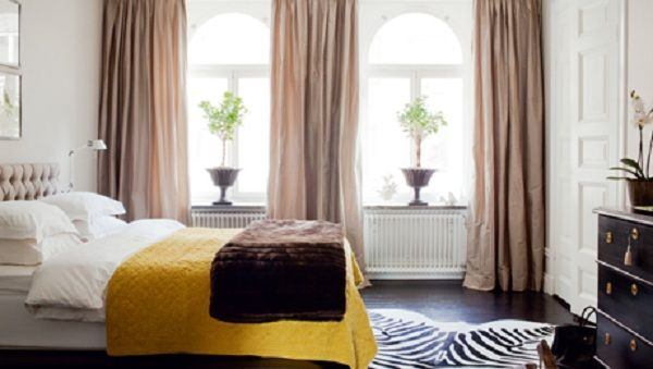 Simple bedroom/strong lines.  Love the potted trees in urns in the windows.