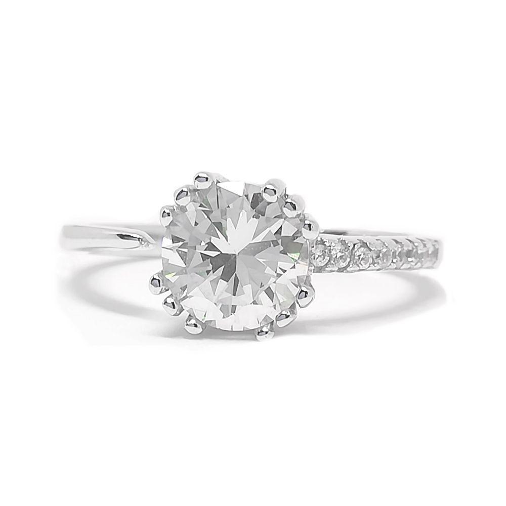 Ασημένιο μονόπετρο δαχτυλίδι απο ασήμι 925°με λευκή κεντρική πέτρα ζιργκόν  Swarovski και μικρότερες λευκές 9be024cffd2