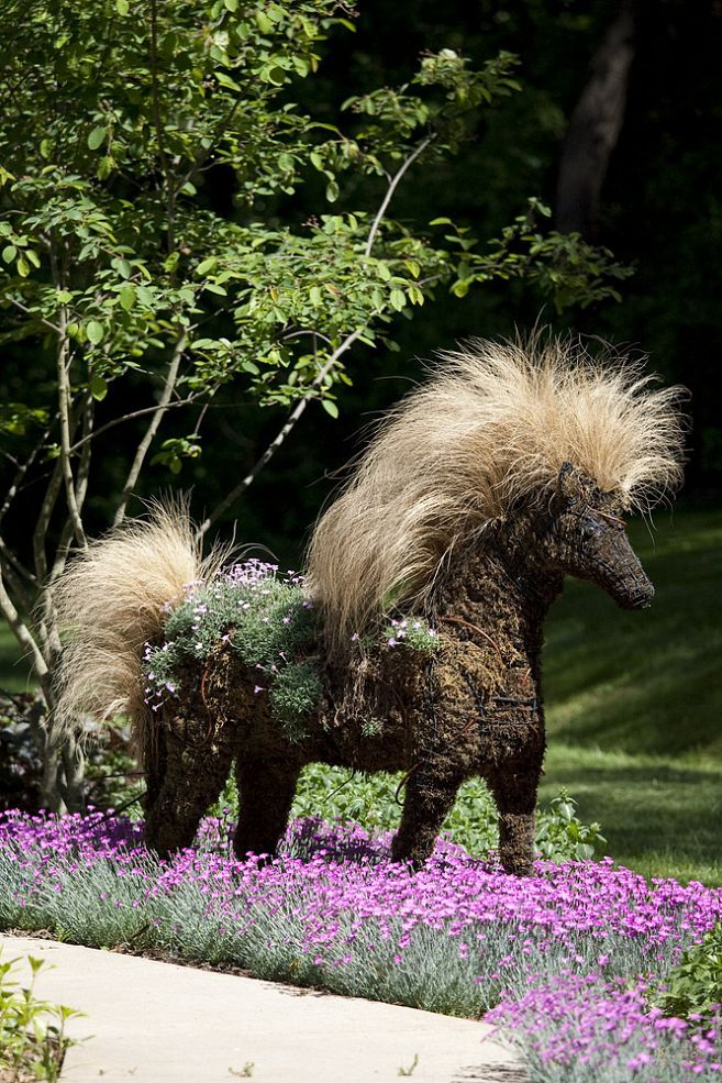 Topiary Horse planted with and among perennials.