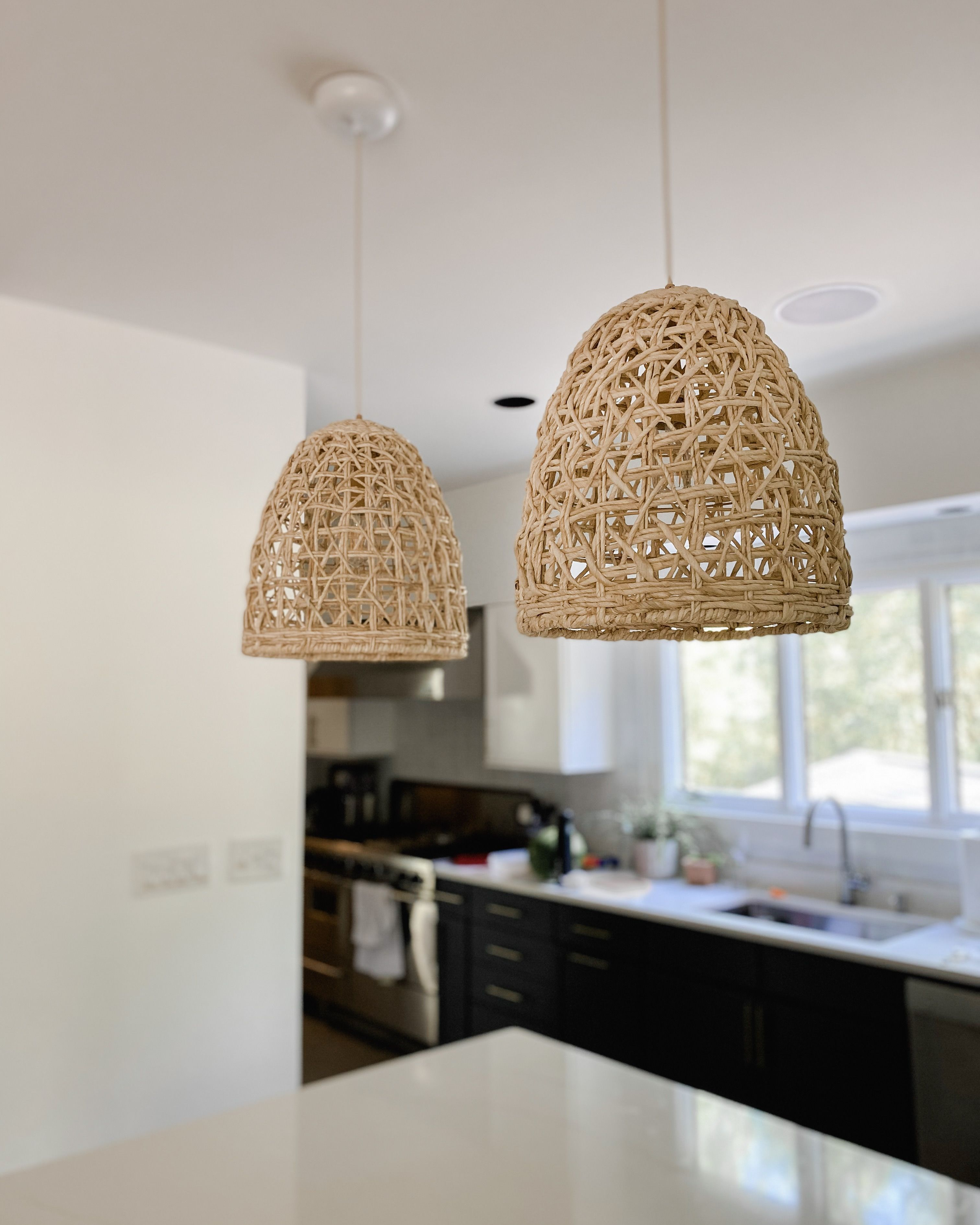 These seagrass pendant lights are great for the kitchen island or over the kitchen sink. They can also be used in other places within your home like your bedroom or living room. If you are working on a new diy project, here is a great idea for adding texture into any room. #Pendantlight #kitchenisland #kitchenpendant #rattanpendant #farmhousependantlight #farmhouse #farmhousekitchen #diykitchen #remodel