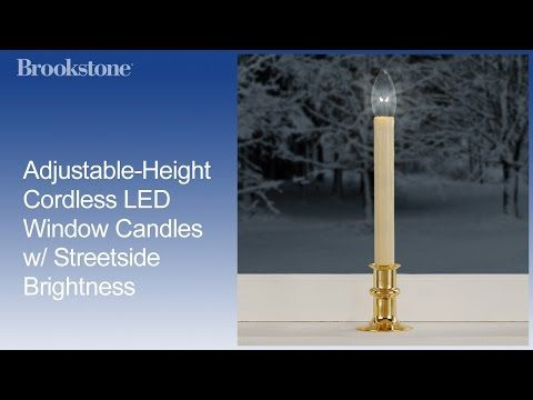 Adjustable-Height LED Christmas Window Candles at Brookstone—Buy ...