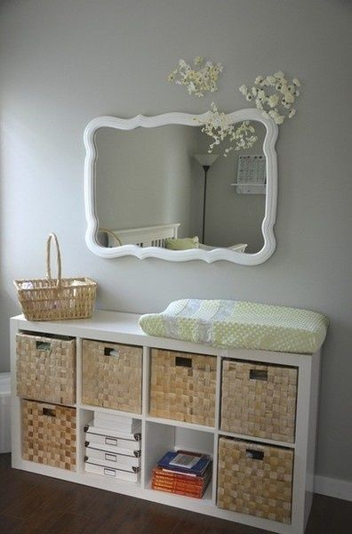 Ok, so yes this is in a baby's room... but I really love the look of those straw baskets & white shelves! Cute alternative to a dresser perhaps.