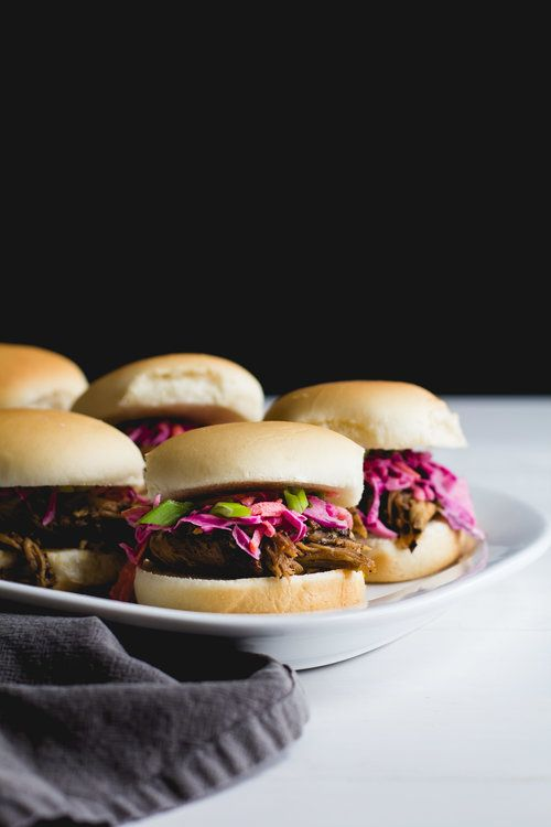 Coffee Rubbed Pulled Pork Sliders with Red Cabbage Slaw - This slow cooker recipe is perfect for a crowd, and it also freezes well! The coffee flavor complements the pork and isn't overpowering, so even those who aren't coffee fans will love it. It's sweet, savory, and smoky with a hint of spice at the end. Top the pork with a tangy, creamy homemade slaw, and serve it on slider buns. So good! Get the recipe from    Sarah J. Hauser