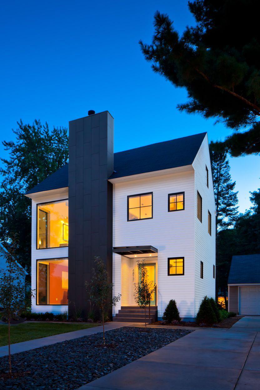 The White House Fertighaus black white exterior on modern home vertical paneled siding