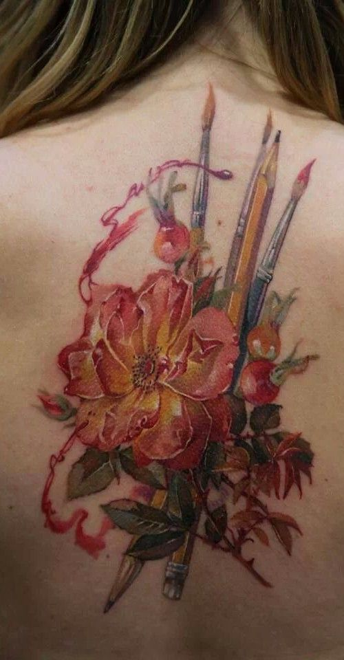 Brush and Pencil Tattoo on back