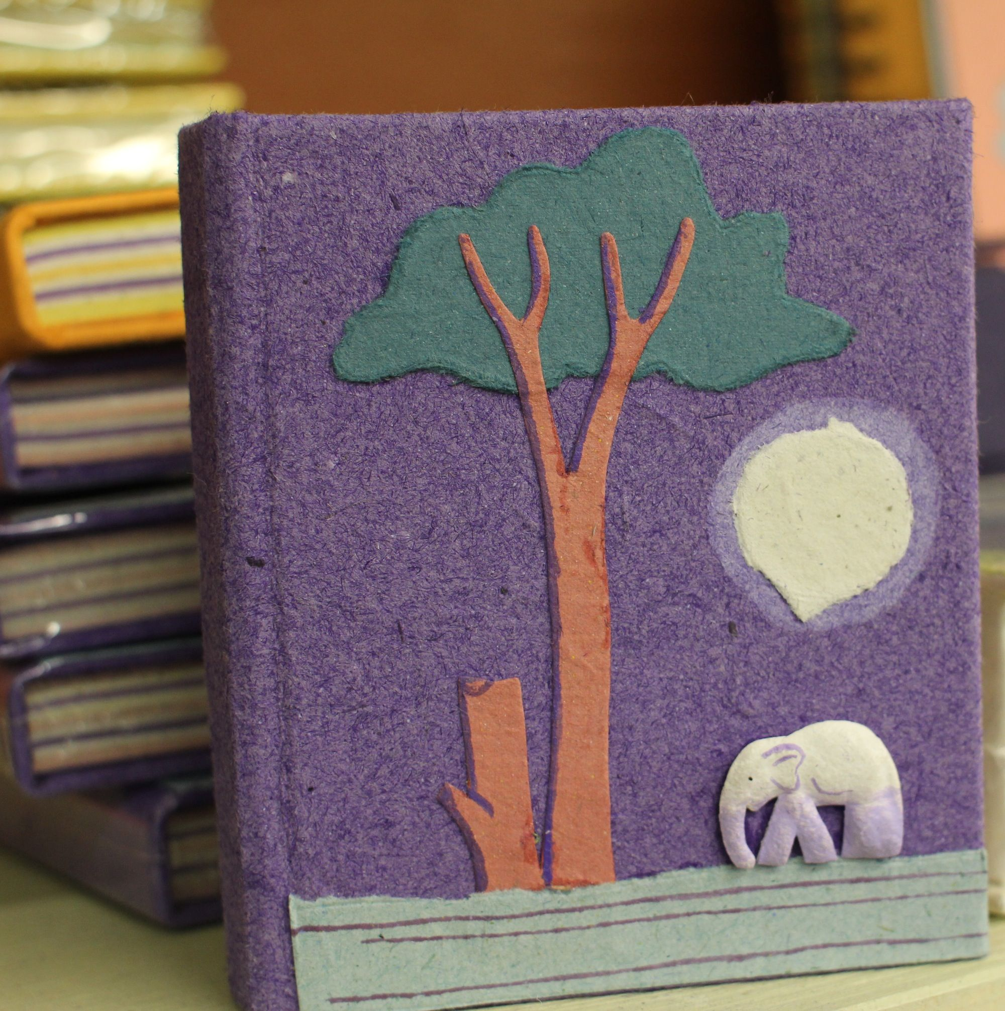 This little fair trade, handmade notebook is made of a mixture of elephant dung and post consumer paper in Sri Lanka by the 'Mr. Ellie Pooh's Elephant Dung Paper' group.