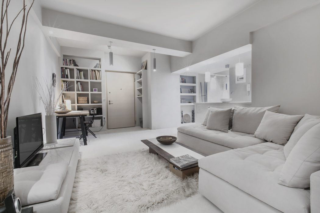 Knusse woonkamer met lichte kleuren interieur inrichting for Interieur woonkamer