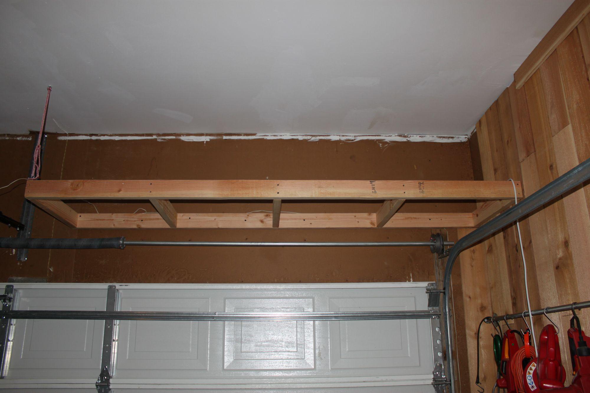 Captivating Elegant Storage Loft Above Garage Door Regarding Your House
