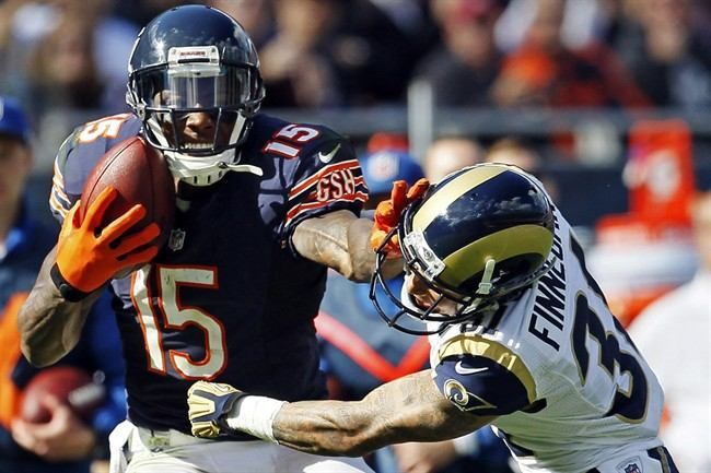 Chicago Bears wide receiver Brandon Marshall (15) makes a catch against St. Louis Rams cornerback Cortland Finnegan (31) in the second half of an NFL football...