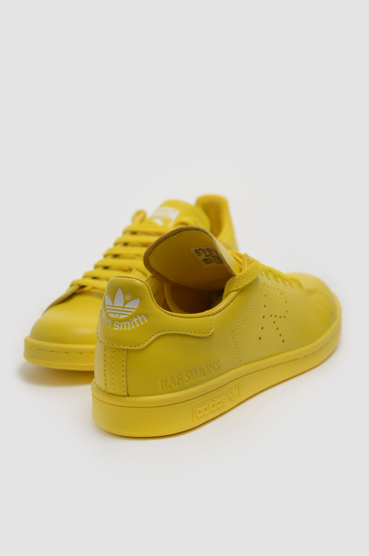 quality design 1b7bc 77fd1 ADIDAS X RAF SIMONS Stan Smith Yellow Sneakers
