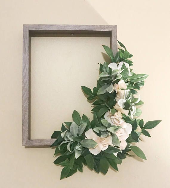 This is a 14X11 wooden gray frame with artificial white flowers and ...