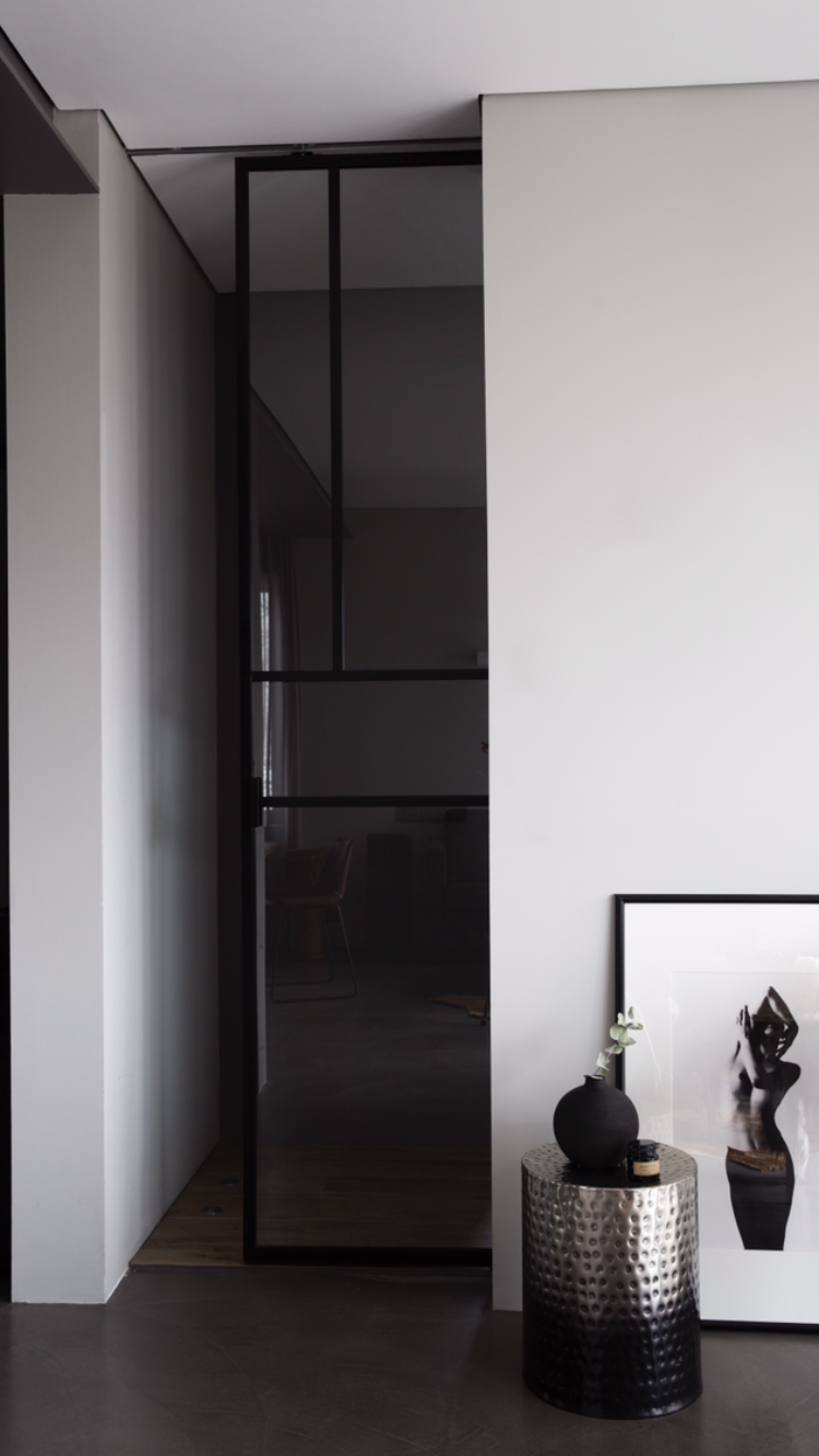 Metal frame glass door inspired by Mondrian painting. Styled with ...