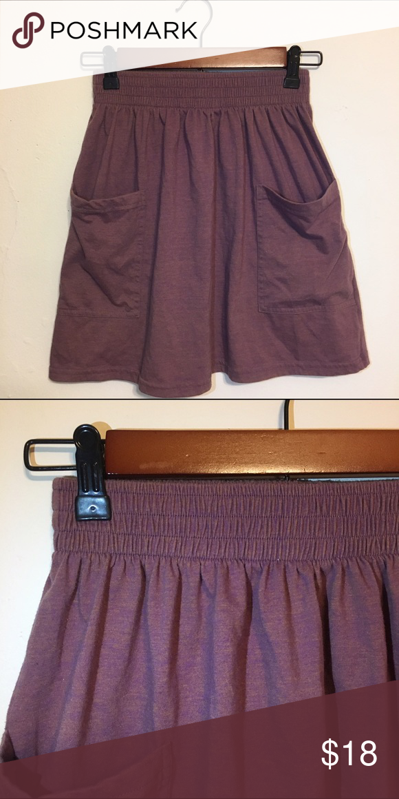 American Apparel Jersey Pocket Skirt Super comfy cotton blend high rise skirt. Awesome double pockets and elastic band. Purple color with gold/tan tint. American Apparel Skirts