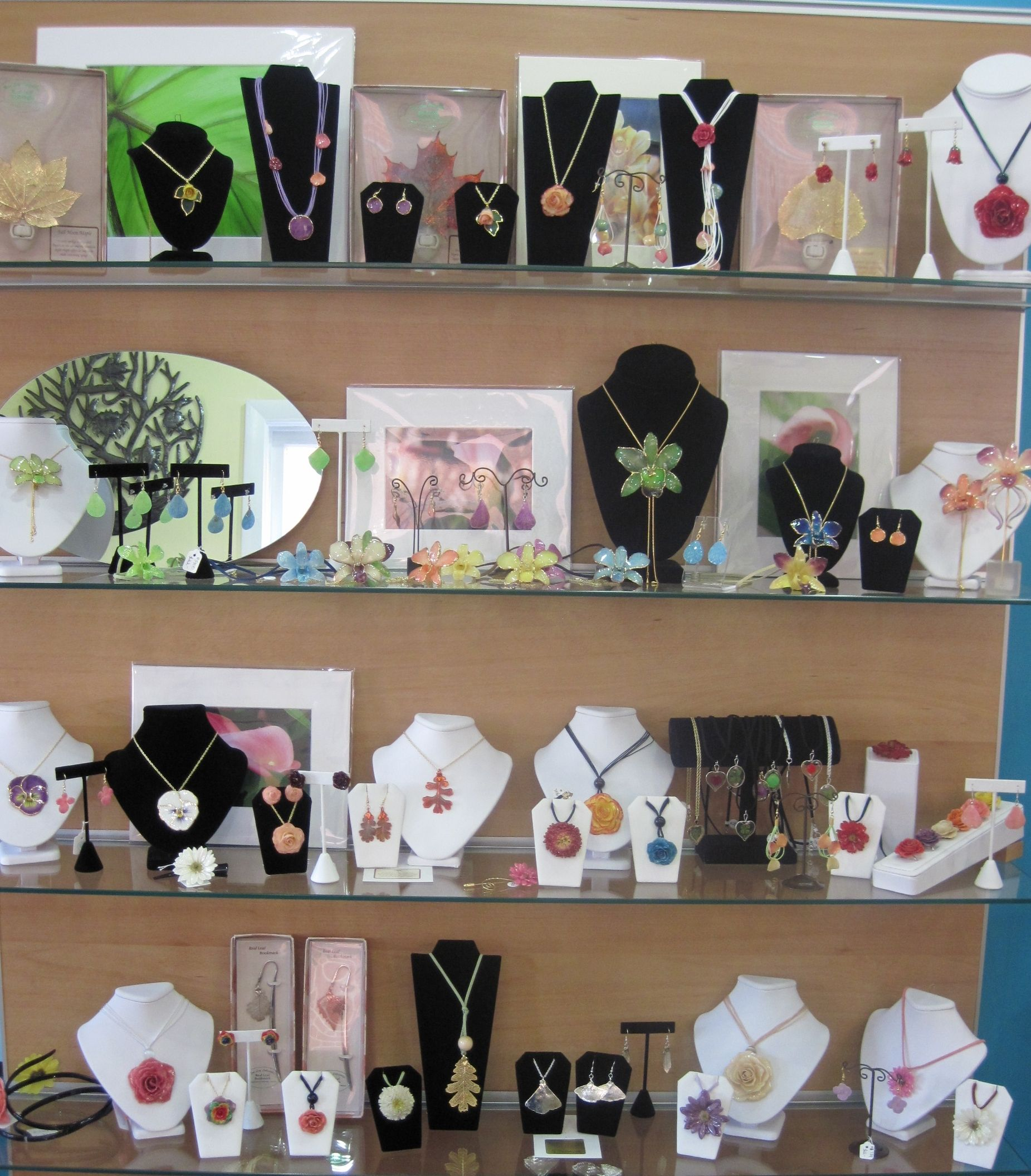 "We carry real flower & leaf jewelry from ""The Rose Lady"""