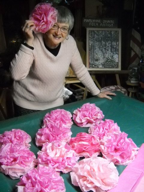 marlynne creates daily big pink tissue roses for church valentine banquet