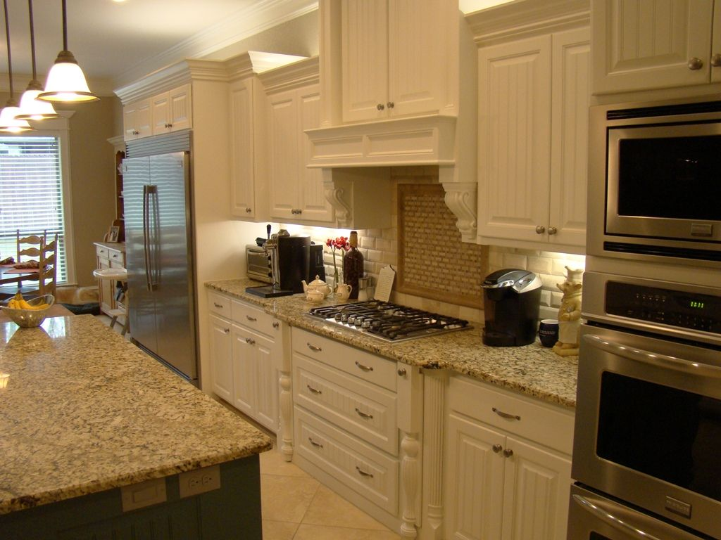 Not Your Standard White Kitchen Island Features A Complementing Green Color And Beautiful Granite Countertops And S Unique Kitchen Kitchen Decor Kitchen