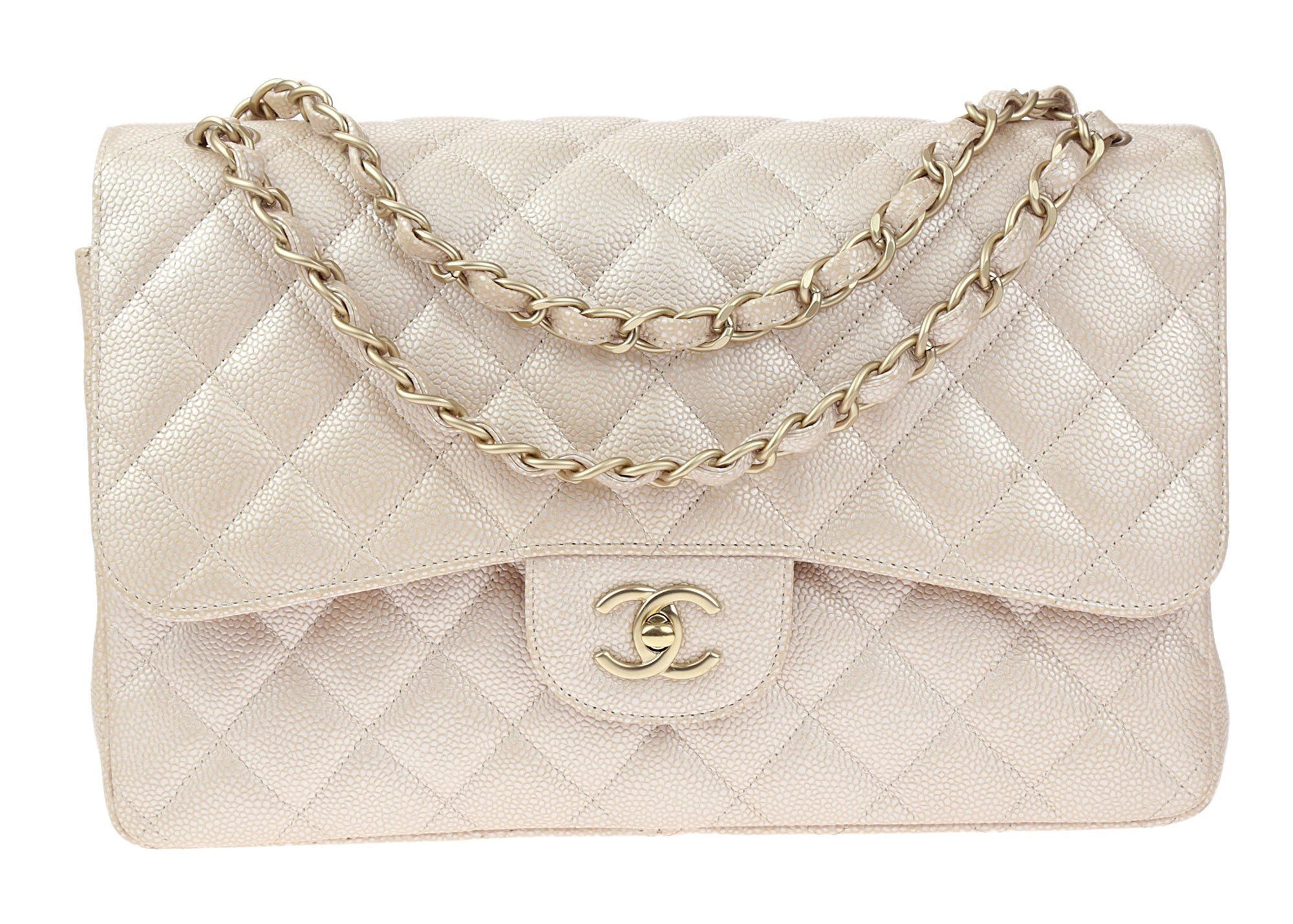 df5cc92b7de1 The double flap features a beige caviar leather with a pearl sheen and  diamond quilting with matte gold h. This Chanel Pearly ...
