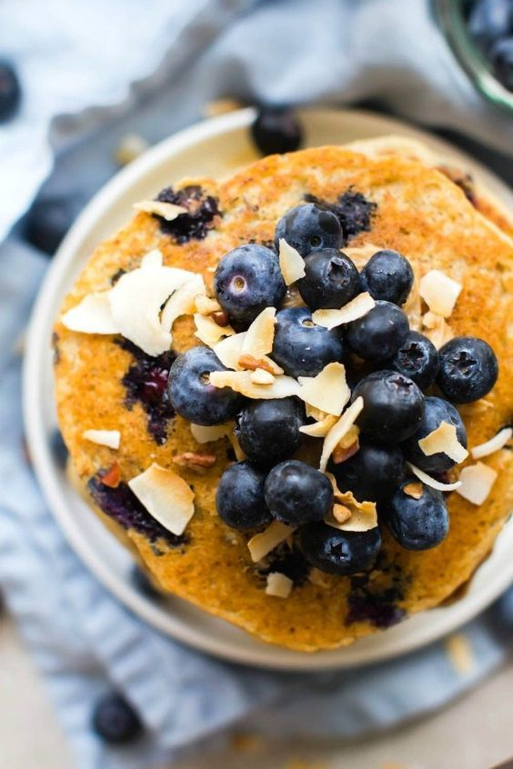 Thick   Fluffy Flourless Blueberry Smoothie Pancakes (V, GF, DF)- Egg-free and healthy blender pancakes made in minutes- Protein-packed, low carb, low calorie and sugar free! {vegan, gluten free, egg-free recipe}- thebigmansworld.com