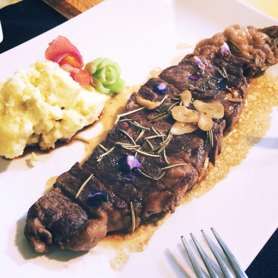 steak, purple edible flower