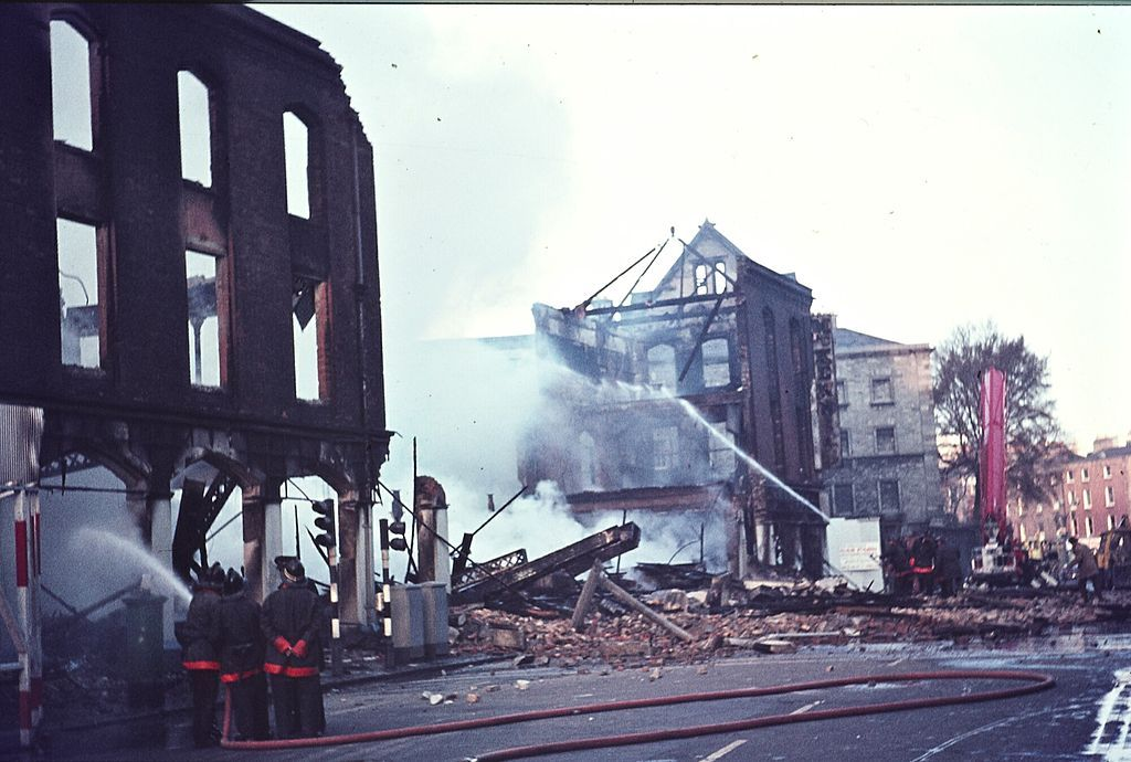 """Dublin Fire Brigade The aftermath of a huge fire at Thomas McKenzie & Sons Ltd. on Pearse Street, Dublin. Friday 10 April 1970: """"A serious congestion of traffic was experienced throughout the day in central Dublin yesterday following the fire which destroyed the entire three-storied hardware store of Thomas McKenzie and Sons, Ltd., at Pearse street shortly after 5 a.m."""
