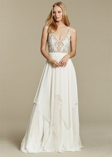Blush by Hayley Paige 1607 Honeycomb Ivory chiffon beaded A-line bridal gown, V-neck bodice with lattice detail and floral applique, full tiered chiffon skirt.