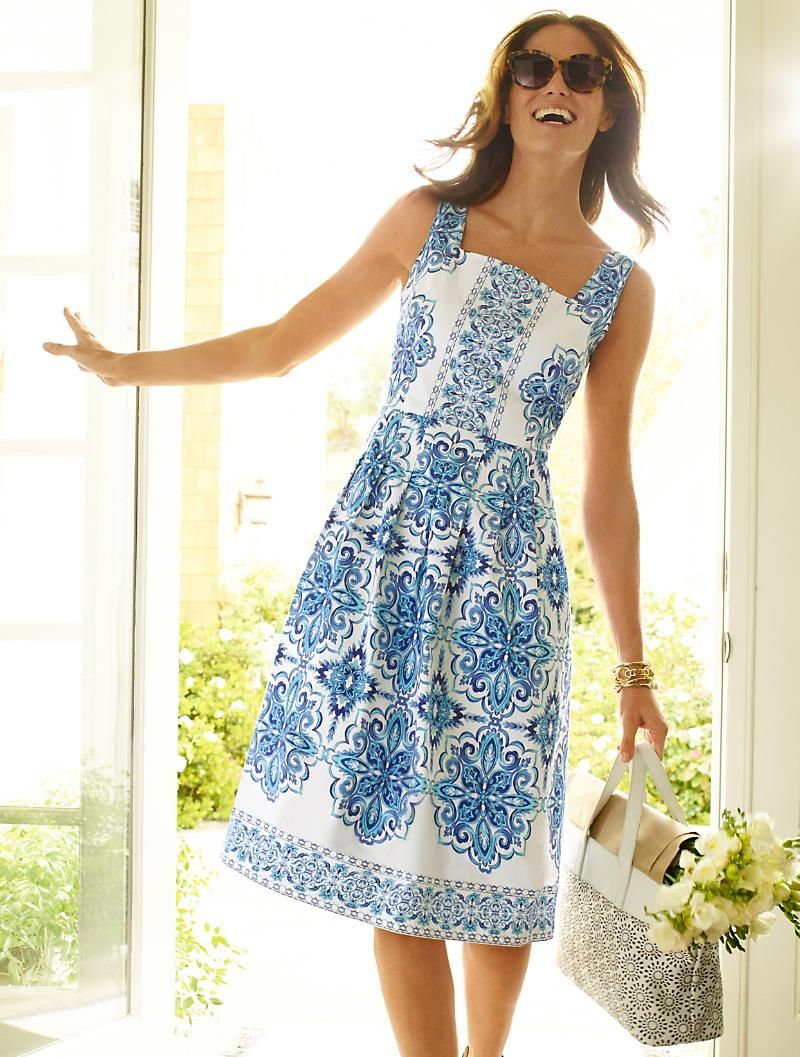 3d4a0ddd498 Inspired by the blues of the Mediterranean Sea, this alluring Grecian tile  print takes new shape in the form of our flattering fit-and-flare dress.
