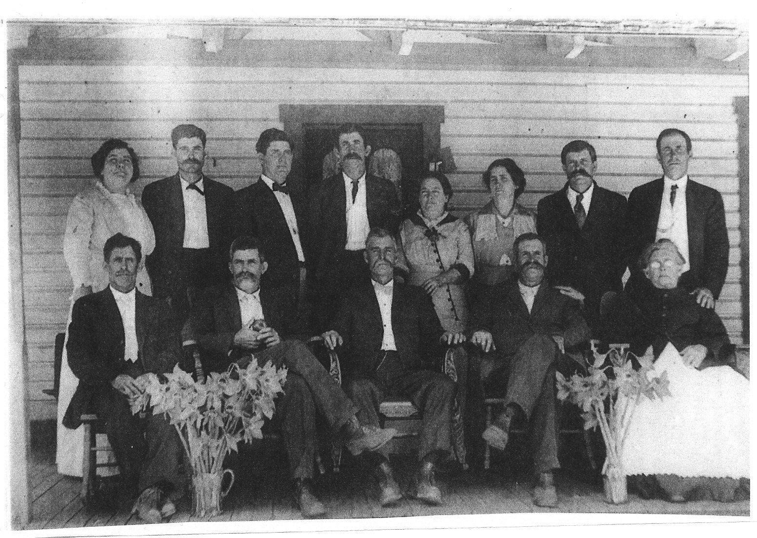 """Prine Family: May have been taken at the funeral of Henry Alfred Prine 1907. stdg lt 2 rt: Martha """"Mattie"""", Henry Bloxon """"Block"""". Leon, Dallas, Anne, Margaret, Lawson, & John Charleston """"Chart"""" std lt to rit: Shelton, Morgan, Robert, Thomas, Catherine R Prine not in pic: Ellen (married); Helen (died as a child)"""