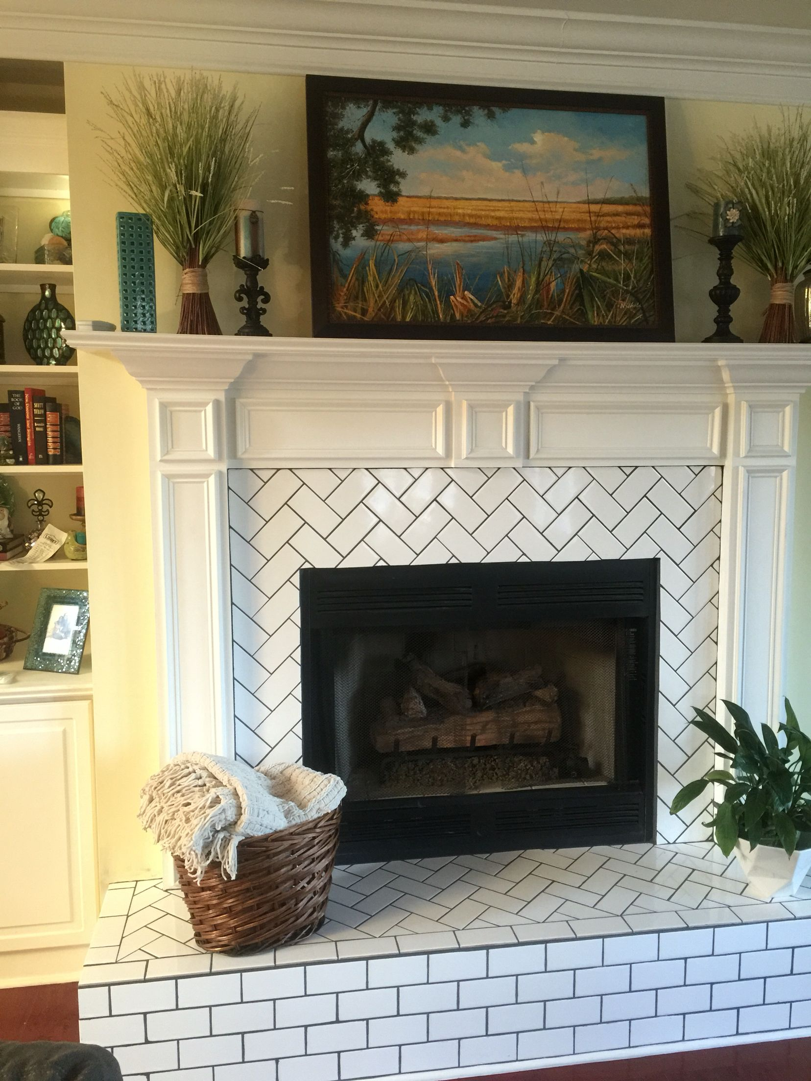 Herringbone pattern subway tile fireplace hearth and surround update.                                                                                                                                                                                 More