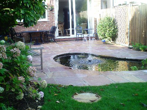 A Patio Pond In A U0027makeoveru0027 Garden With Indian Stone Paving Surround. The