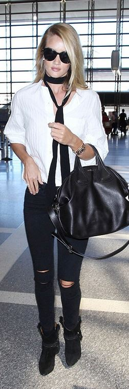 Rosie Huntington-Whiteley: Purse – Givenchy  Shoes and shirt – Isabel Marant  Jeans – Paige  Watch – Rolex