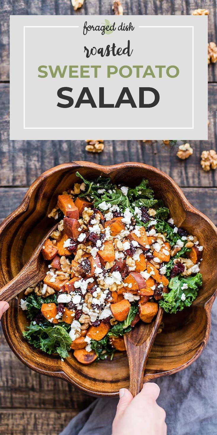 Photo of Fried sweet potatoes are served in a salad with kale, dried cranberries, walnuts …
