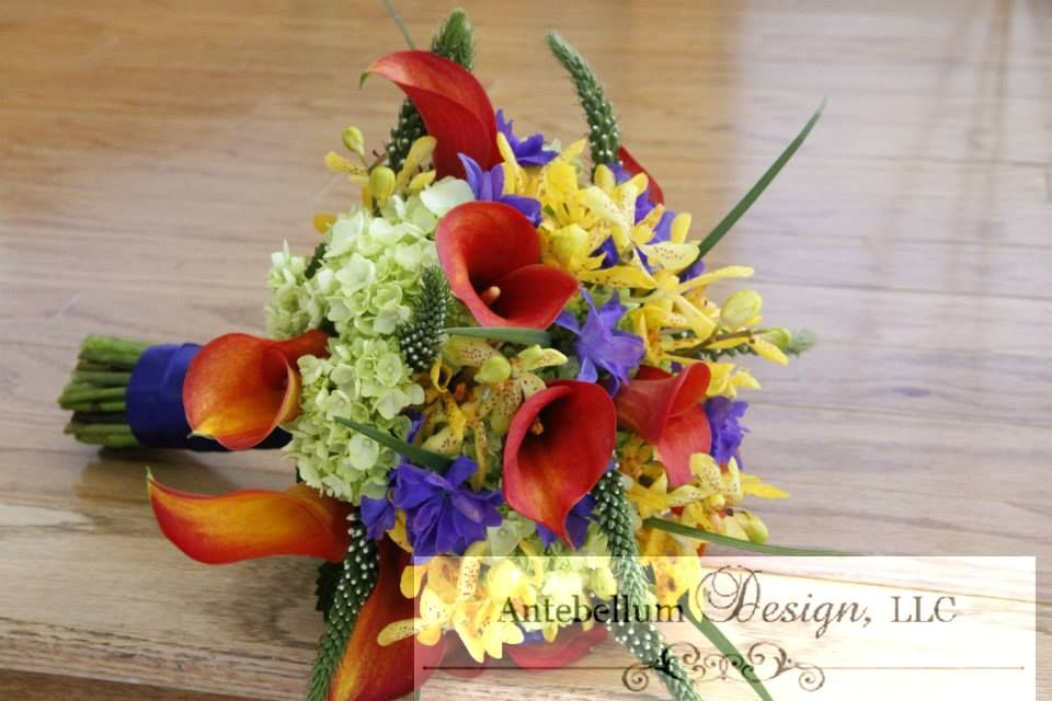 Orange And Blue Bouquet With Wedding Flowers Like Calla Lilies Veronica Delphinium