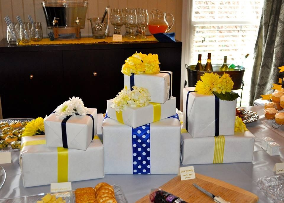 Centerpiece Made Up Of White Wrapped Gift Boxes Navy And Yellow Ribbon And Yellow Fresh Flowers Navy Baby Showers Party Event Birthday Celebration