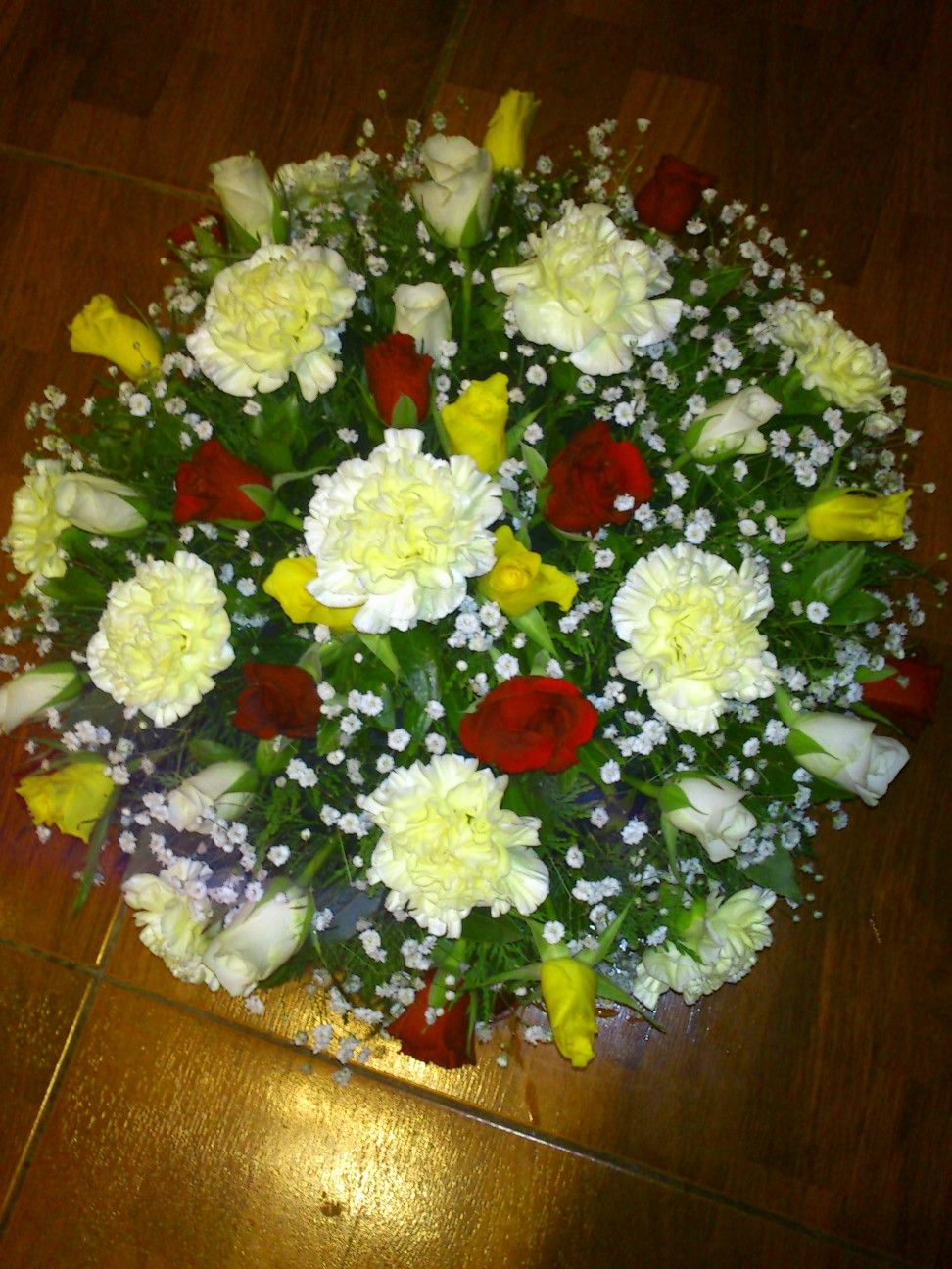 Buds white and red and gold funeral flowers for a rosary devotee funeral flowers for a rosary devotee izmirmasajfo Image collections