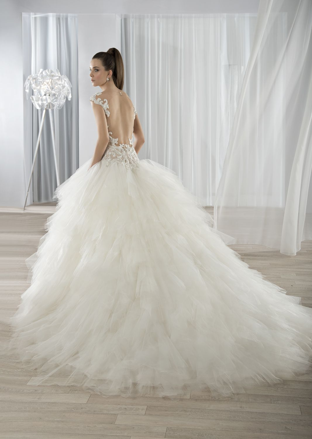 7bd5228a3fdc Dropped-waist Tulle ball gown with dramatic low back. Extravagant  multi-tier tulle skirt and Chapel train. #DemetriosBride Style 611.