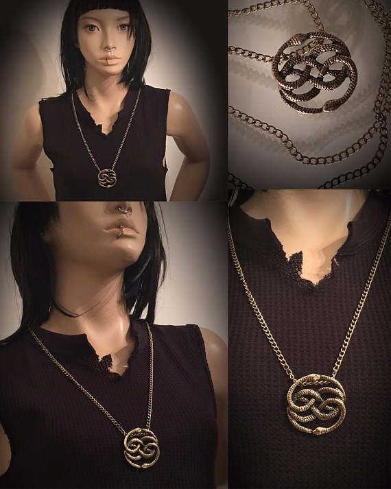 The AURYN Necklace from The Neverending Story🖤  The pendant comes with a matching gold colored chain.  Necklace Length: 27 inches