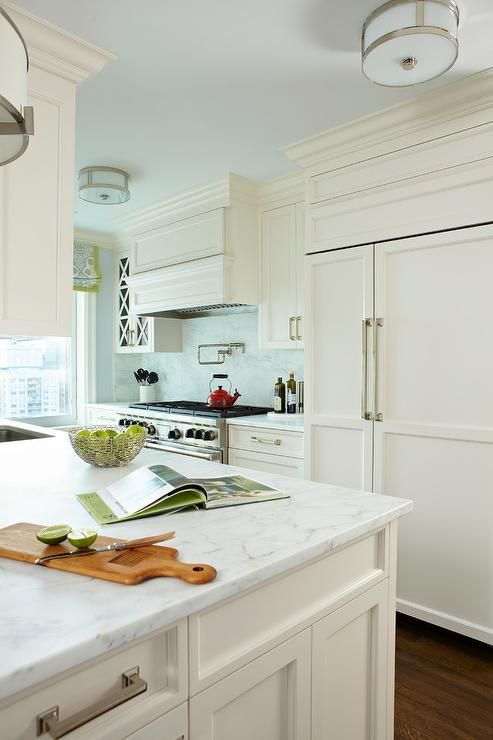 Off White Kitchen Cabinets With White Marble Countertops And