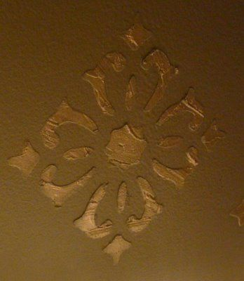 Adding texture to walls with stencils and spackling