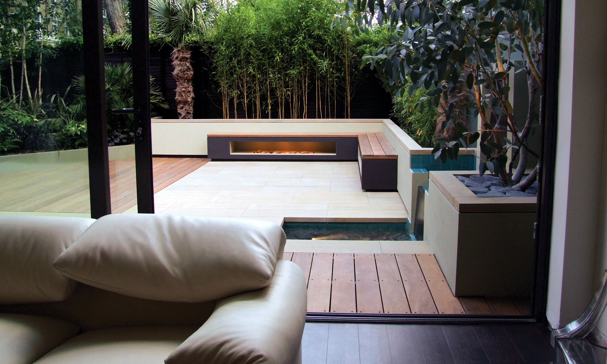 the l shaped bench picks up on the shape of the interior white leather sofa - L Shape Garden Decor
