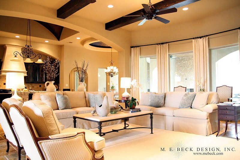 scale of furniture in great room - fills the space nicely. Love cream colors & different textures.