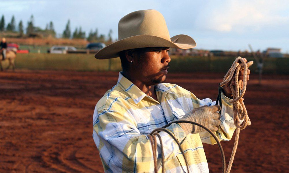 """""""Where the Clint Eastwood cowboy is all piss and pistol, the Hawaiian paniolo knows his flower species as well as his cattle breeds."""""""