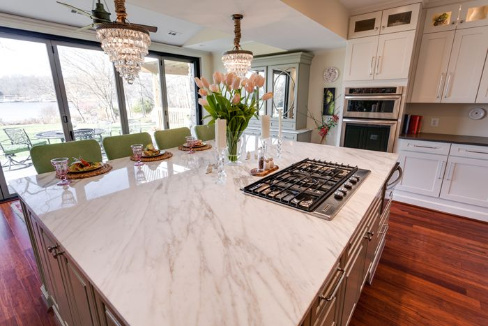 Top view of beautiful white kitchen island with marble - Kitchen island with cooktop and seating ...